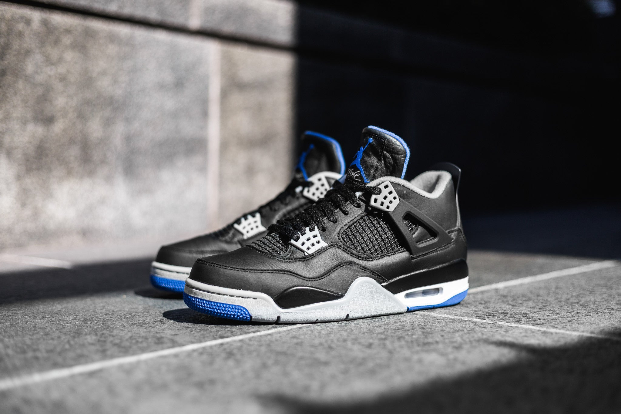"cb57c027 The Air Jordan 4 Retro ""Motorsports Away"" takes the original colourway to  the dark side with high-grade materials with a touch of blue and white  accents."