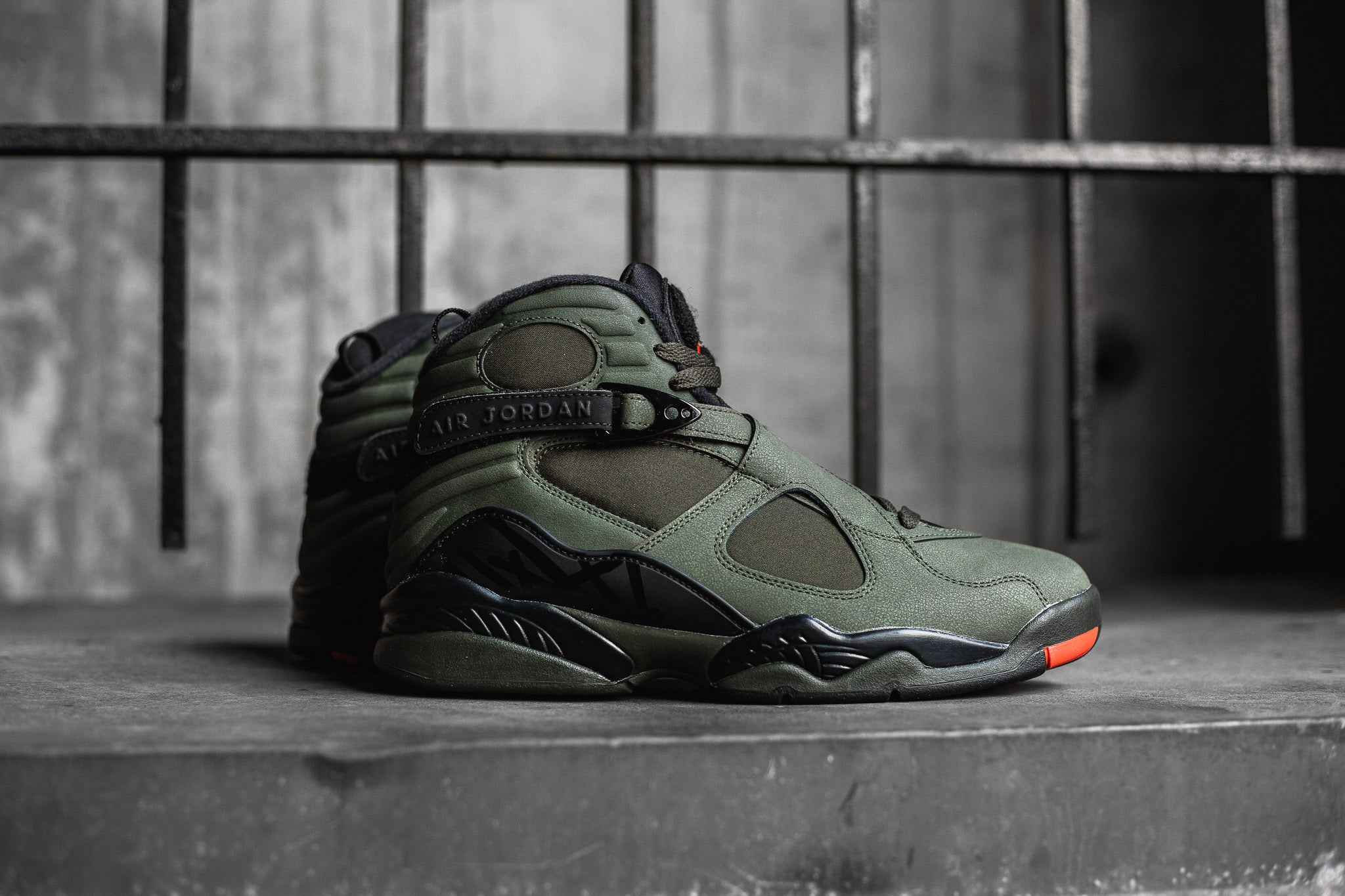"5c002afa443367 The Air Jordan 8 Retro ""Take Flight"" showcases an olive drab   orange flight  jacket colourway. Sharing a close resemblance to the 2006 UNDFTD collab"