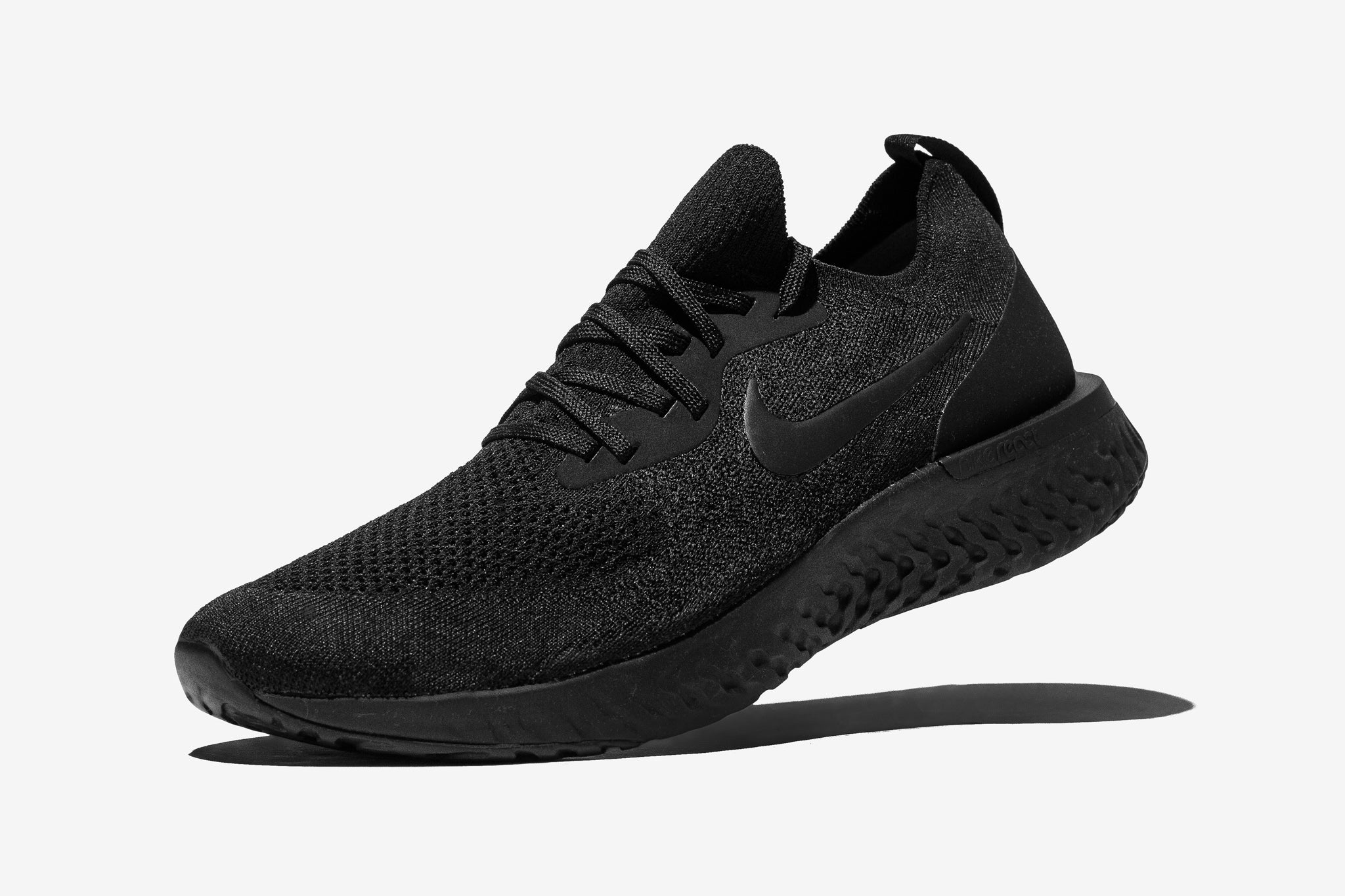7a6df26f498 Back with the triple black, Nike Epic React Flyknit readies your feet for  your athletic endeavours with a stealthy new paint job.