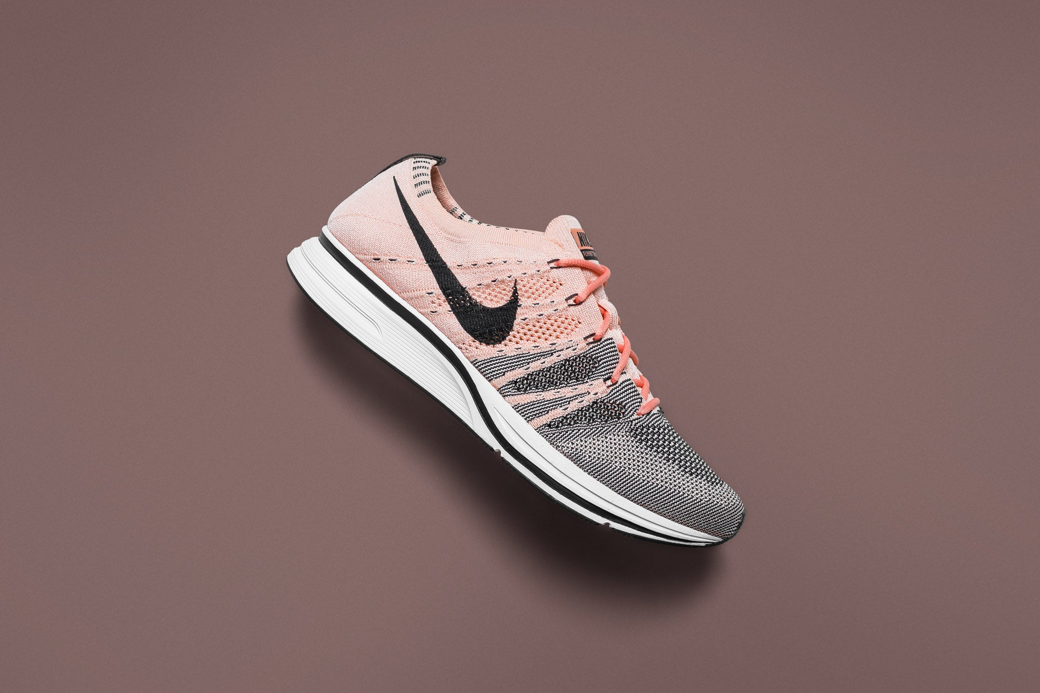 fbac11e548c4 The Nike Flyknit Trainer returns with a solar pink