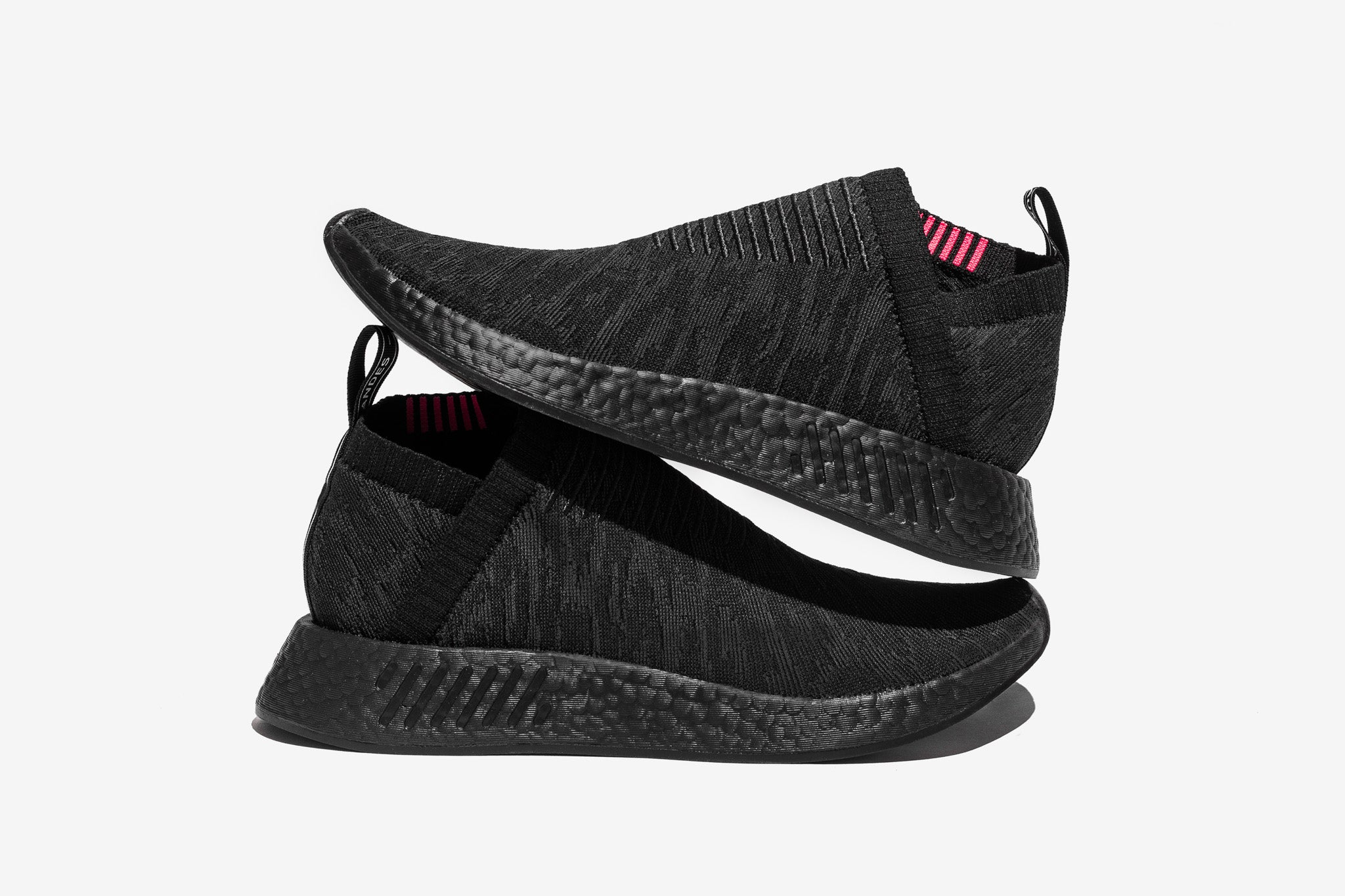 "72e1fdcc4f58e adidas NMD CS2 ""Core Black"" suits up with a triple back colour combination  with pink accents at the inner lining to help this stealthy selection pop."