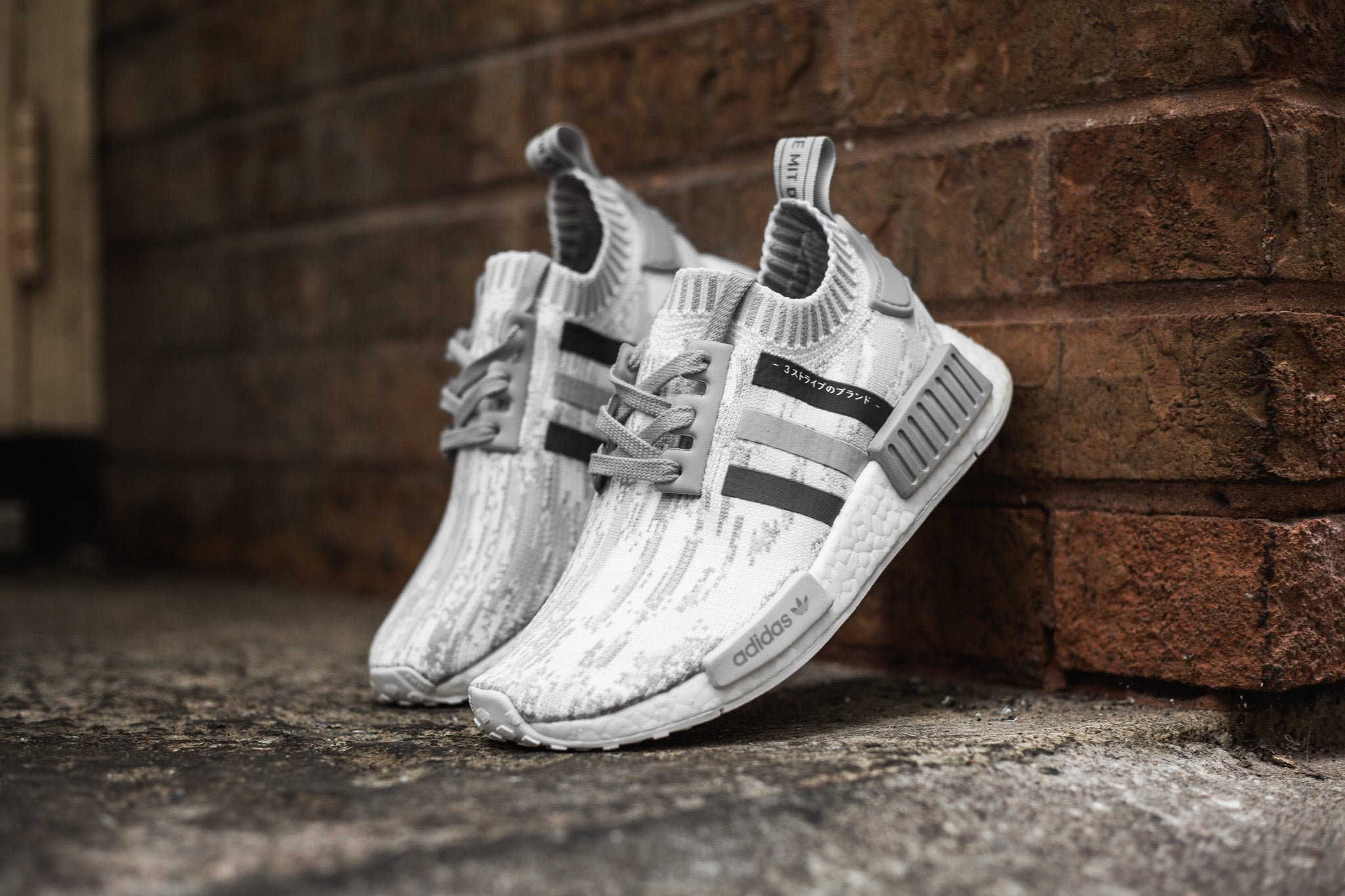The adidas W NMD R1 PK features the glitch digicamo this season with tonal  grey accents decorating the top. The upper construction is made with adidas  ...
