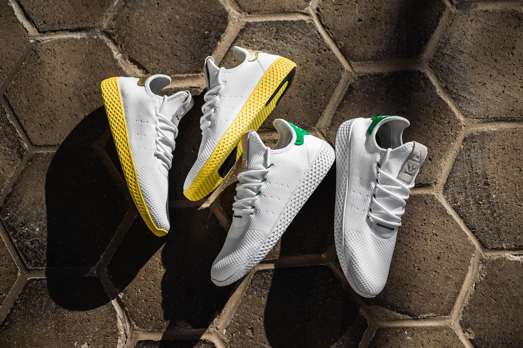 7b5a78f3b21c1 From the forward thinking mind of Skateboard P A.K.A. Pharrell WIlliams  comes the Adidas PW Tennis HU Primeknit. This new sneaker silhouette takes  design ...