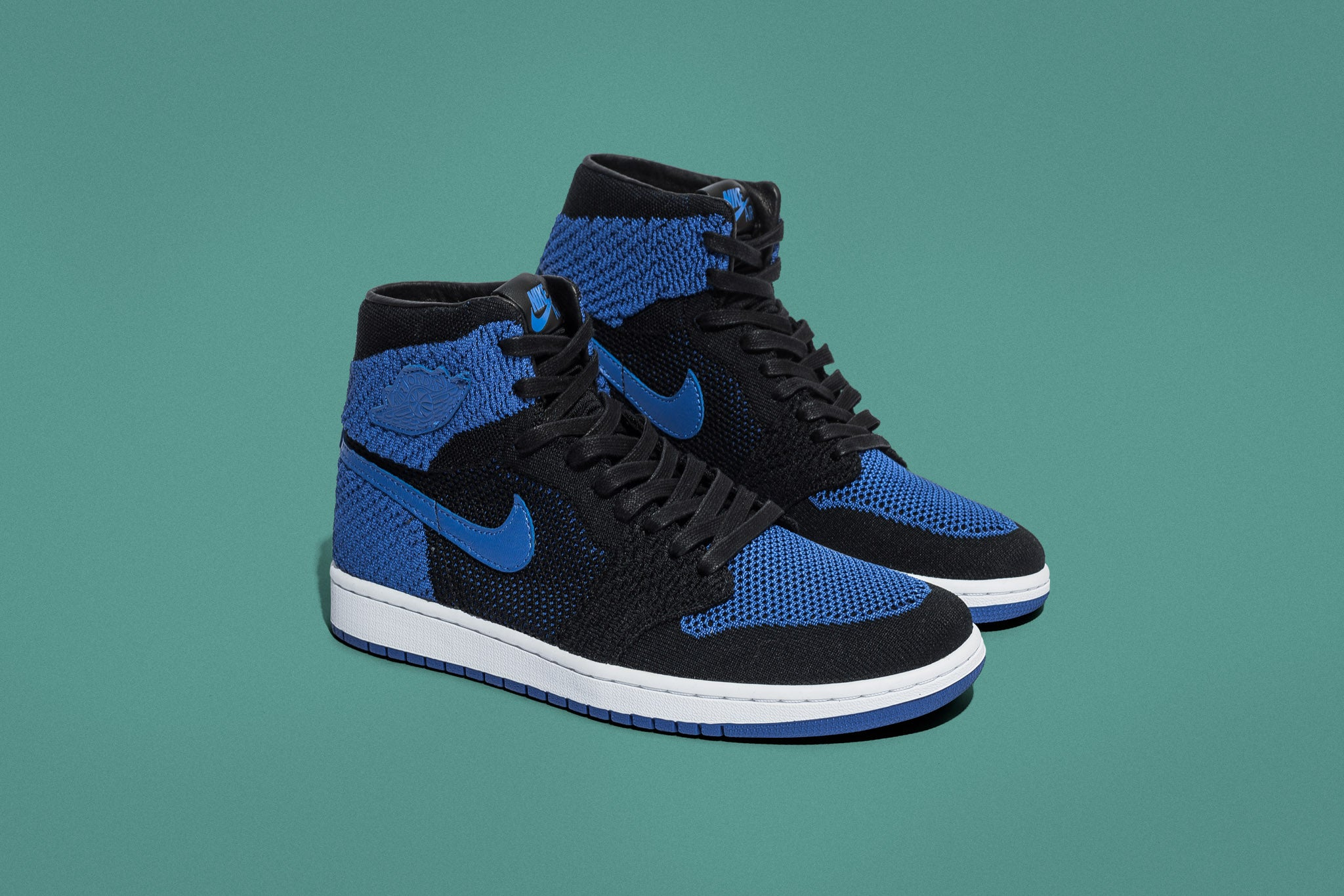 """7f06139f665 The 1985 fan favourite returns with a revamped ultra-lightweight upper to  settle the score on the pavement. The Air Jordan 1 Retro Flyknit """"Royal""""  dresses ..."""