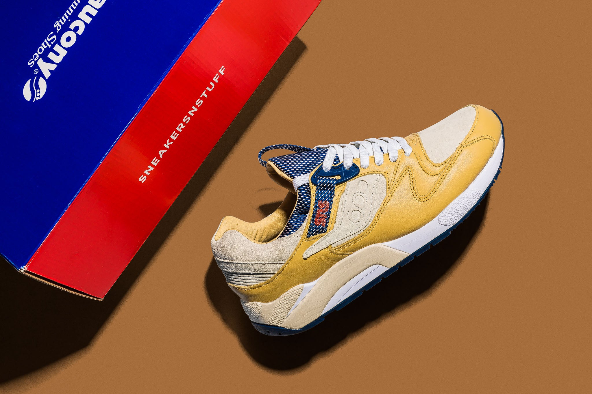 "63ac818bba21 ... up to bring the look and feel of a comfortable business class flight  across the Atlantic to your feet with the Saucony Grid 9000 ""Business  Class""."