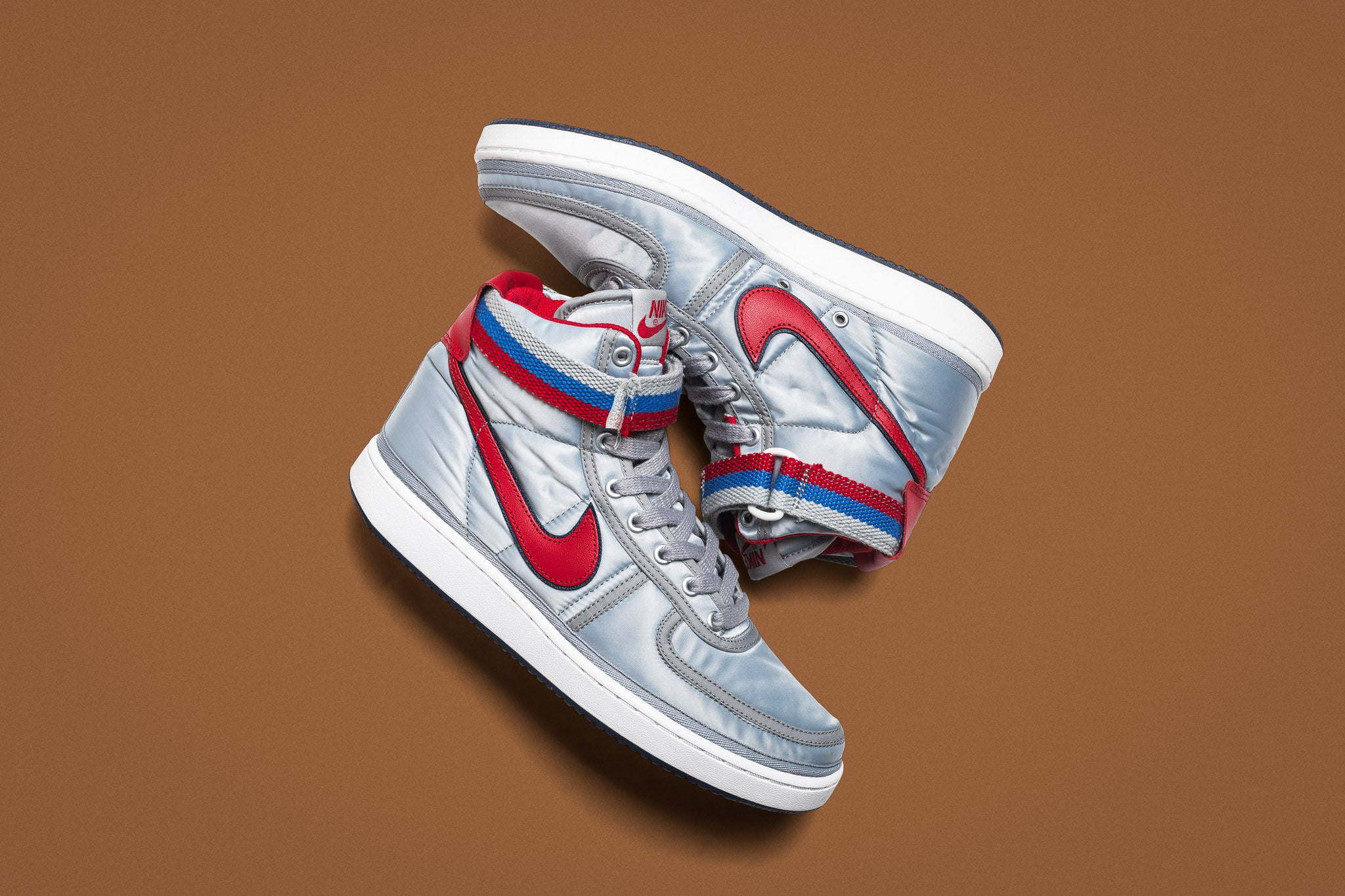 brand new 35194 6eed5 The Nike Vandal High Supreme QS comes back with the bold silver, blue and  red original colourway for the full 80s retro return. Full-on nylon uppers  in a ...