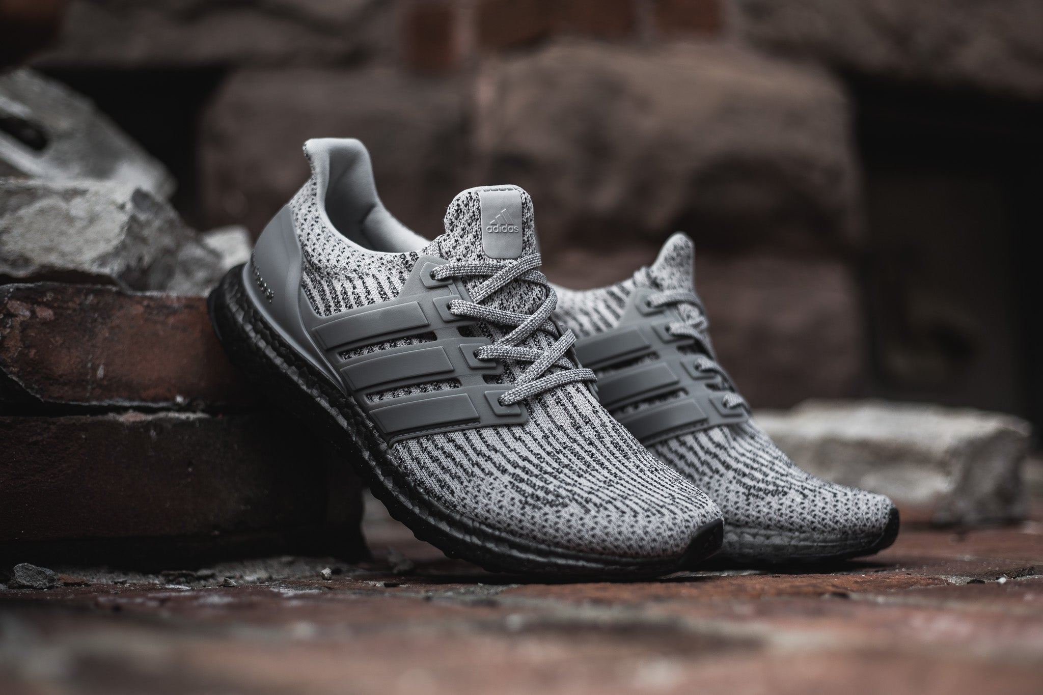 "b151422fc The adidas Ultraboost in ""Triple Grey"" sports a crisp grey and charcoal  colourway that ll suit your street strolling habits. The adidas Ultra Boost  features ..."