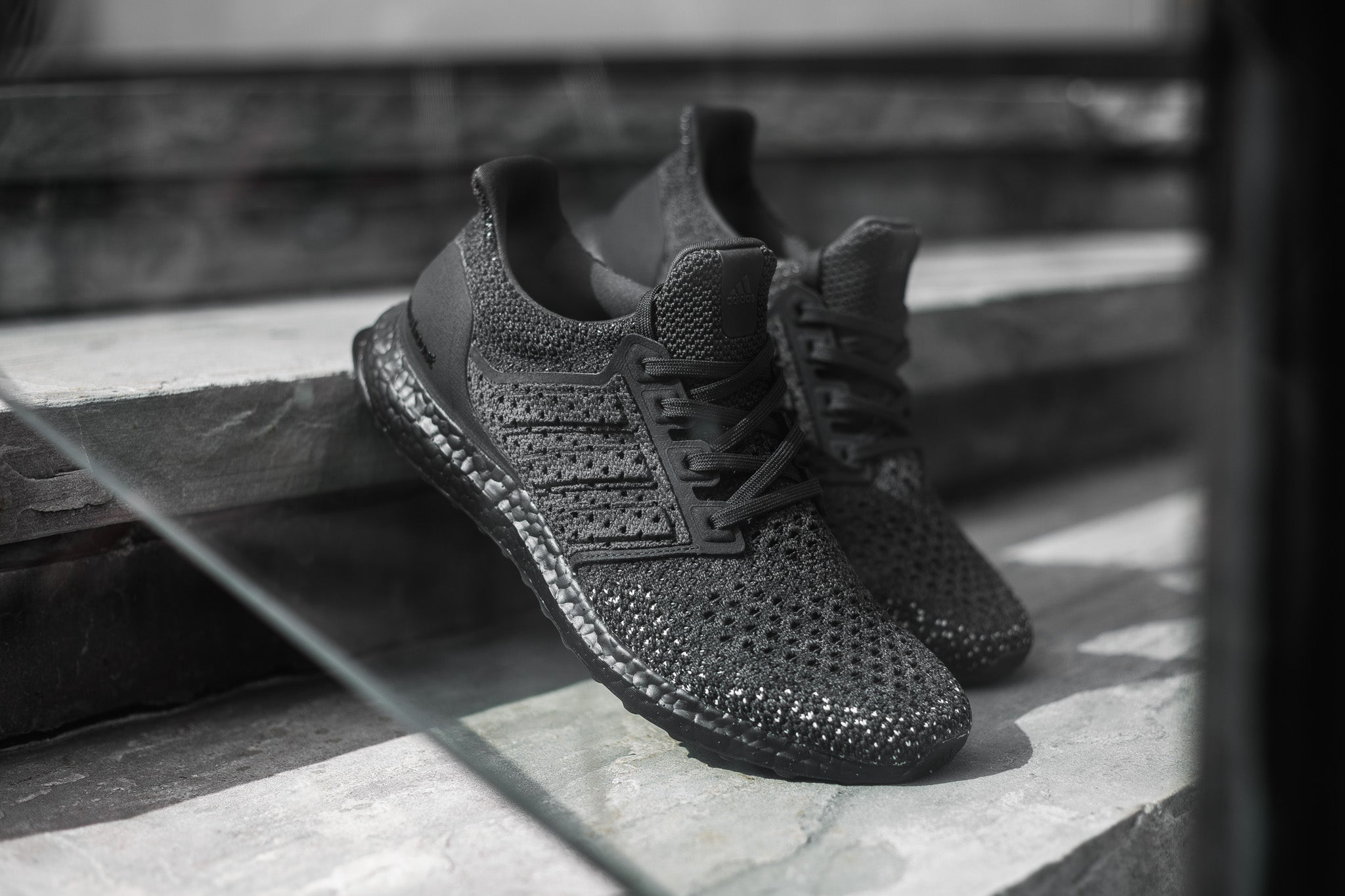 2890abbca3f56 adidas  Ultraboost Clima LTD goes carbon black with a full Primeknit upper  and cage component. The upper is an open knit Primeknit material with ...