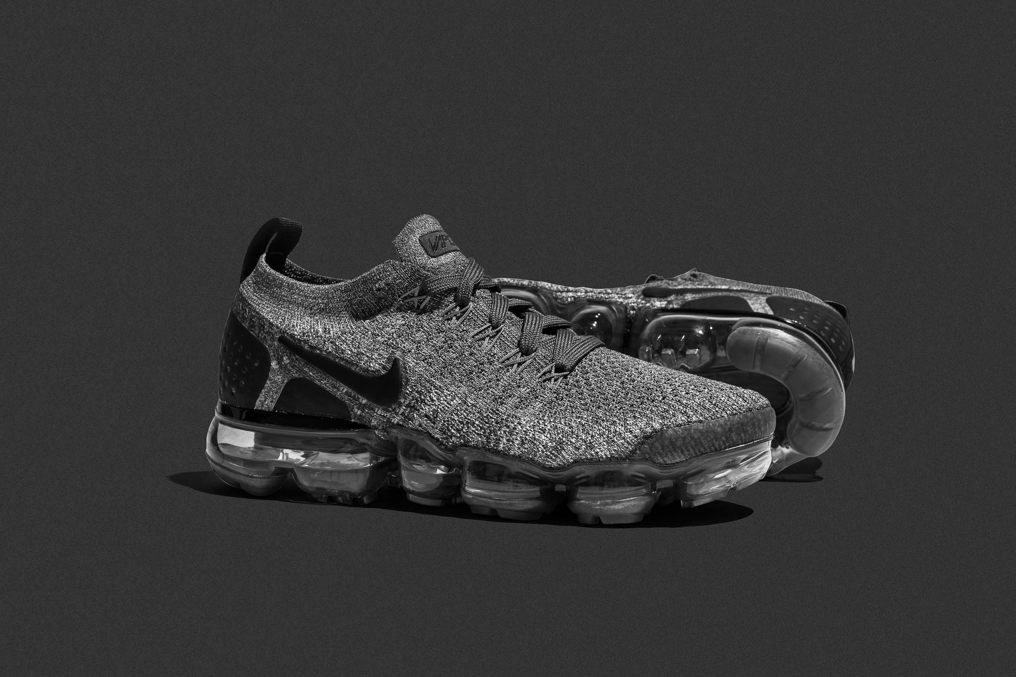 1575ca3487ab1 The latest Women s Air Vapormax Flyknit 2 adds simple and clean dark   wolf  grey uppers to the silhouette. The Air VaporMax Flyknit 2 is made with the  ...