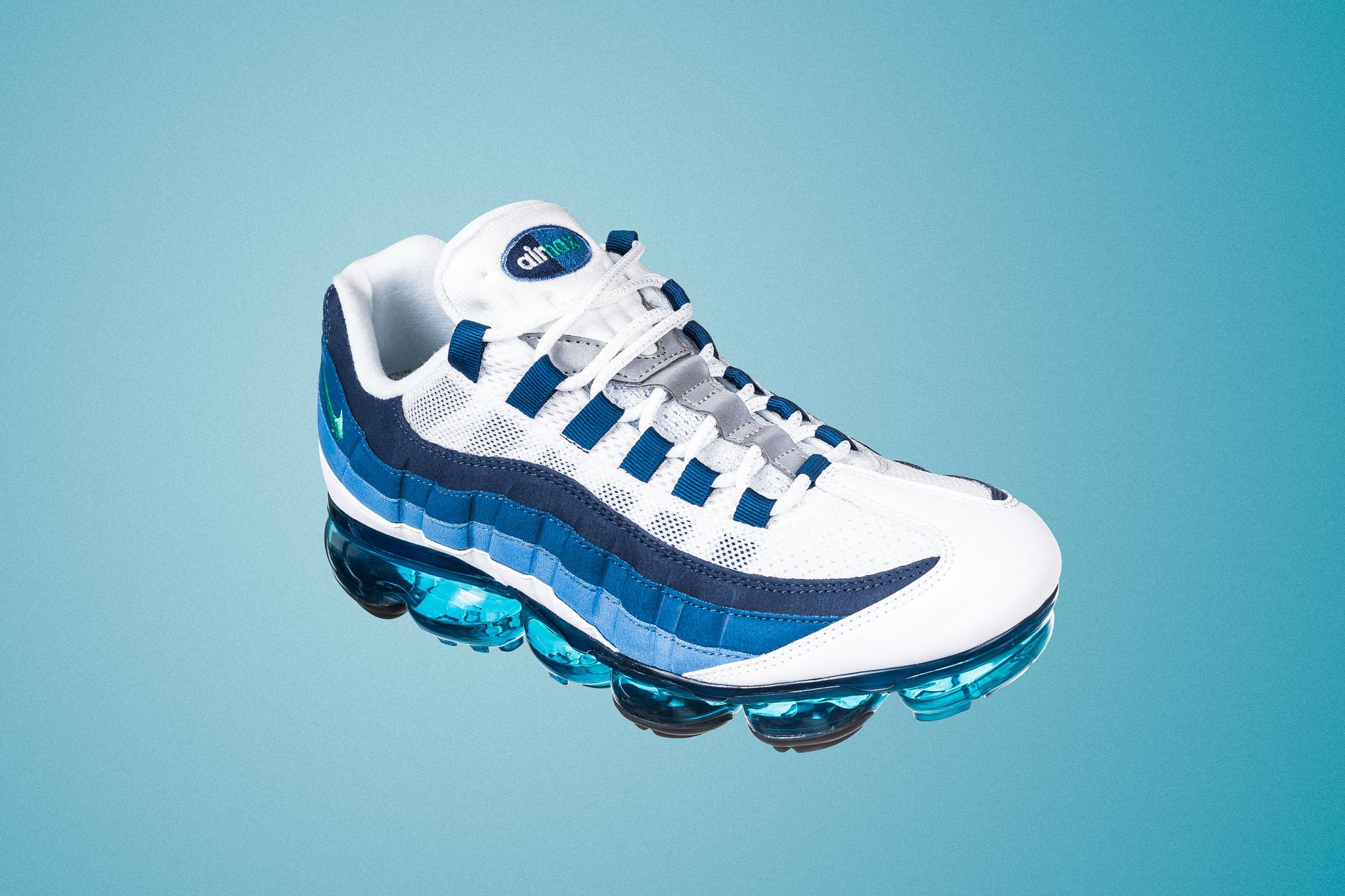 c947ecac8ba4a The Air Vapormax 95 remixes the original Air Max 95 with the Vapormax  cushioning unit decorated with the blue and white highlights along the  outsole tread.