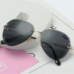Monts Rimless Aviator Sunglasses