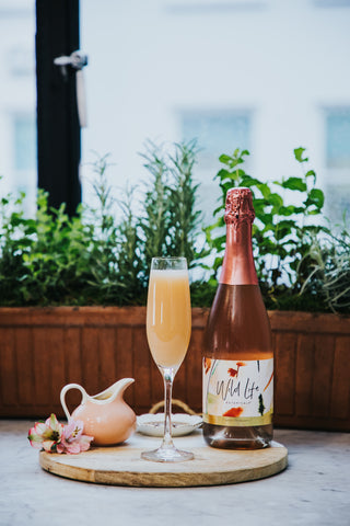 Peach Me I'm Dreaming non-alcoholic cocktail, Wild Life Botanicals Blush andingredients on platter