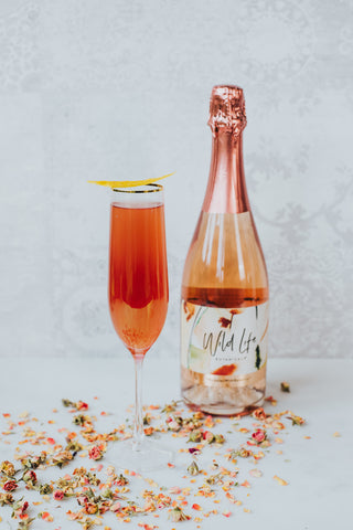Amour non-alcoholic cocktail, with a bottle of Wild Life Botanicals Blush