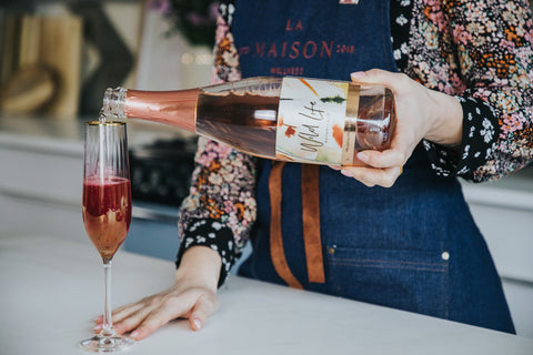 Amour non-alcoholic cocktail, pouring Wild Life Botanicals Blush in the flute