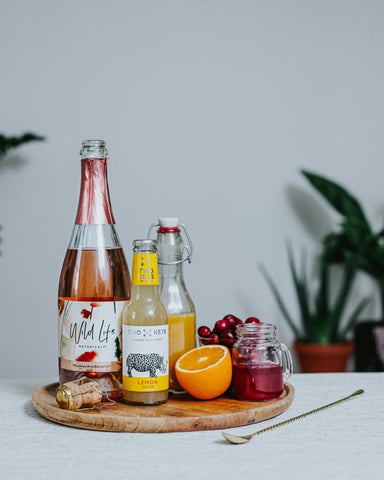 Wild Life Botanicals low alcohol sparkling wine, low-calorie cocktail, low-alcohol mindful cocktail, Festive Mimosa.