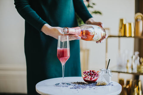 Pouring Chill Out cocktail with Wild Life Botanicals Blush non-alcoholic sparkling wine