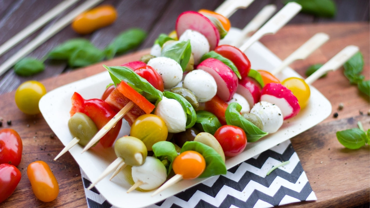 Low carb cold kebabs including cheese, olives, vegetables, and herbs