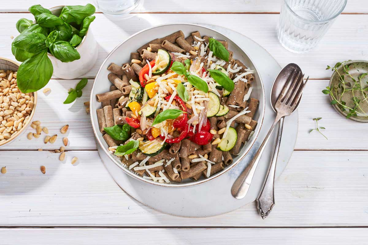 Ingredients for keto Pasta with Colourful Vegetables and Pine Nuts