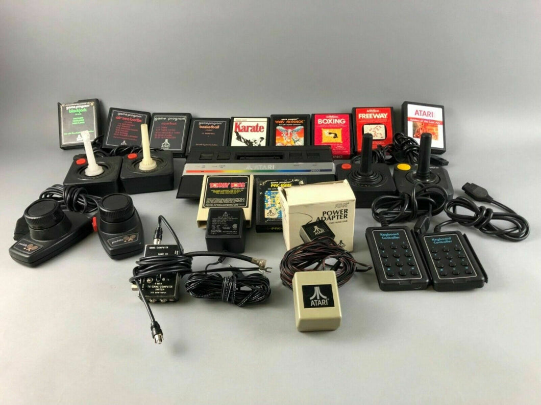 VINTAGE ATARI 2600 BLACK CONSOLE, GAMES AND CONTROLLERS - LOT 2751