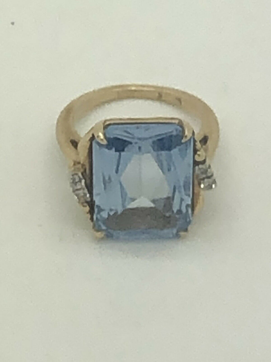 10k GOLD BLUE  EMERALD CUT TOPAZ, AND DIAMIND  RING 6.5g size 5.5  5108