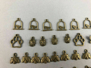 41 ASSORTED MINIATURE ANIMAL BRASS CHARMS - LOT 3528