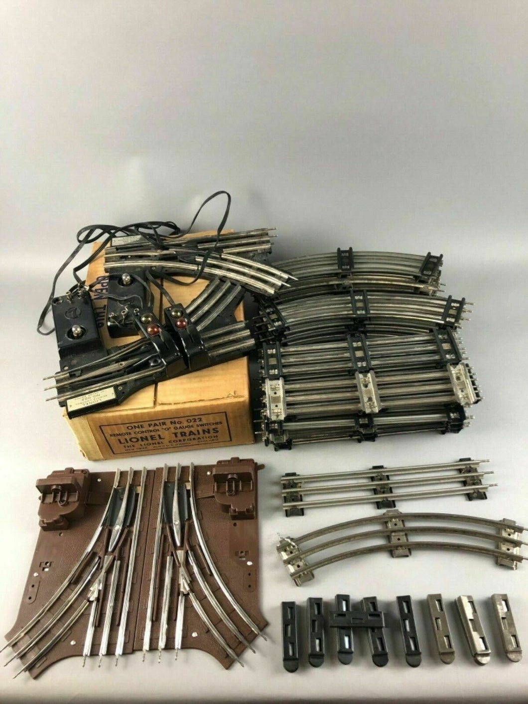 75pcs of LIONEL MAGNETIC TRACK & (2) # 022 REMOTE CONTROL SWITCHES -