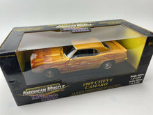 Load image into Gallery viewer, 1 18 ERTL 1969 CHEVY CAMARO GOLD METALLIC W/FLAMES & GOLD TORQUE THRUST WHEELS