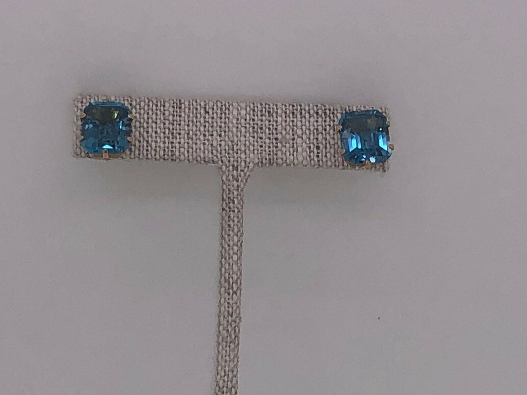 Pair of 14k gold and Topaz pierced earnings.
