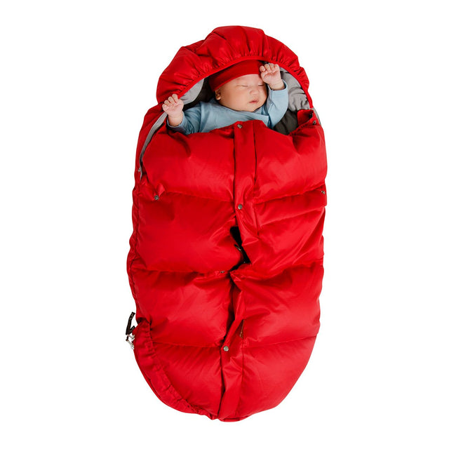 Mountain Buggy durable soft fleece lined sleeping bag zipped up with baby inside in colour red_red