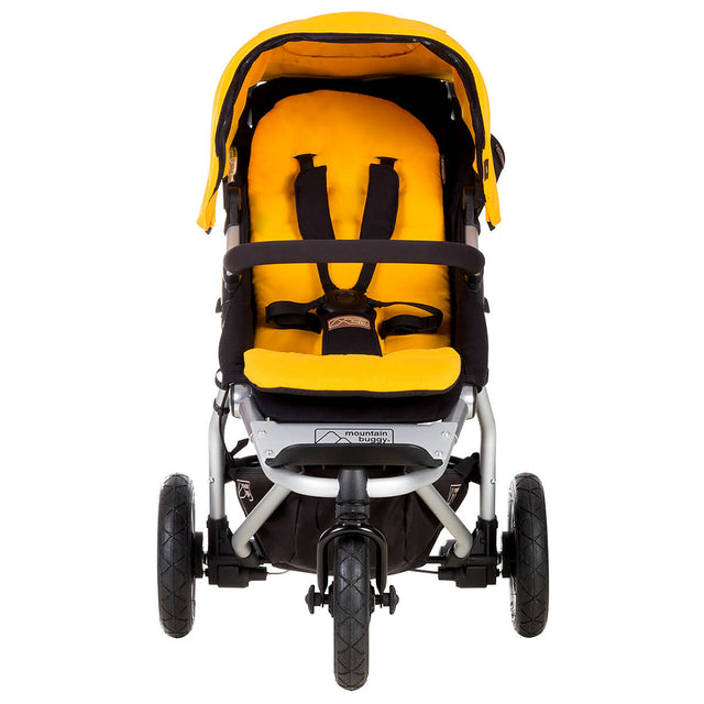 mountain buggy swift compact stroller front view shown in color gold_gold