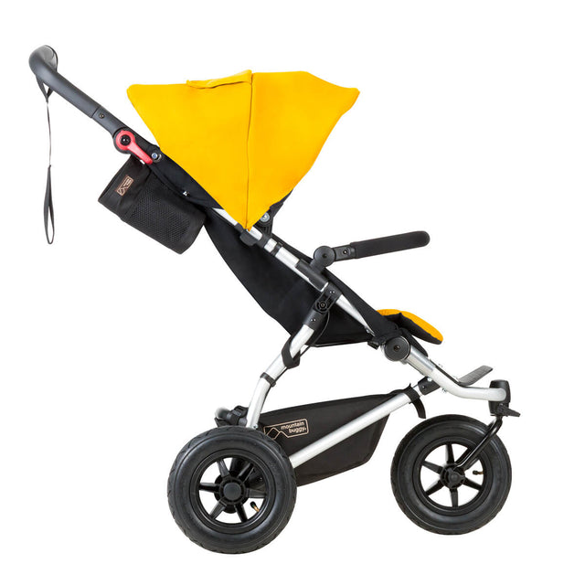 mountain buggy swift compact stroller toddler side view shown in color gold_gold