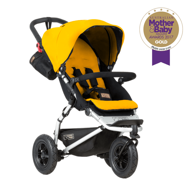 mountain buggy swift compact buggy 3/4 view shown in color gold_gold