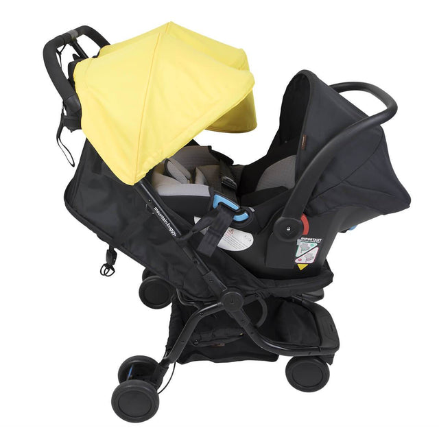 Mountain Buggy nano duo car seat adaptor attached to protect car seat on the nano du stroller side view in colour cyber_default