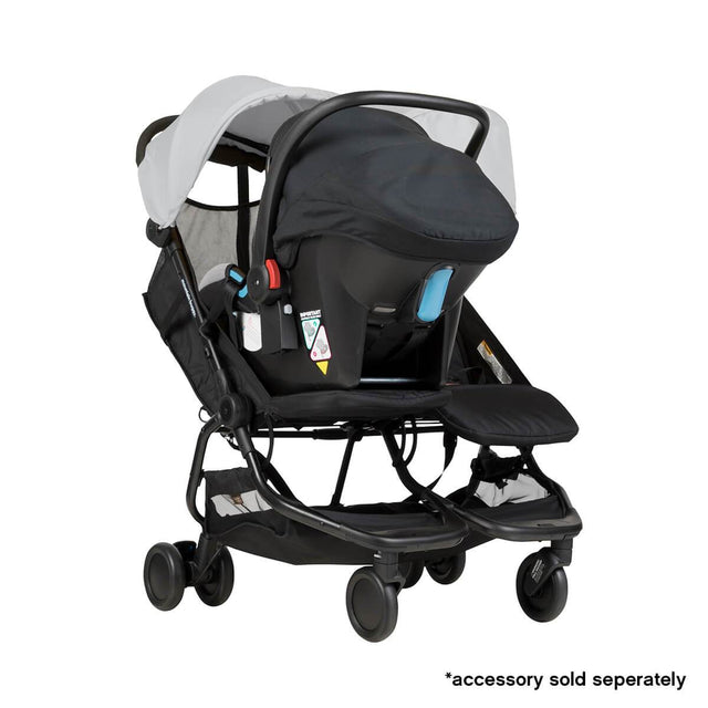 Mountain Buggy nano duo double lightweight buggy fitted with protect car seat in colour silver_silver