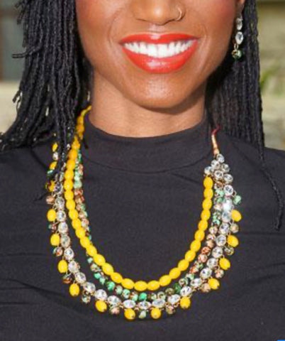 Woman wearing Large bold necklace