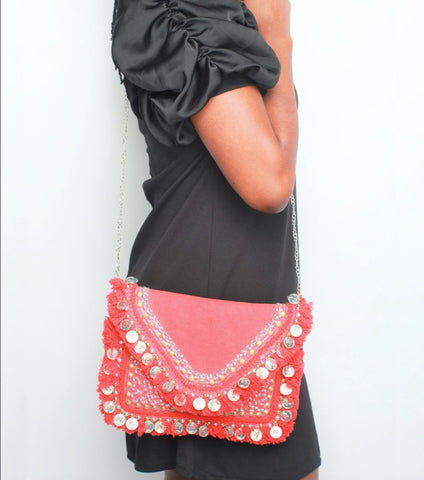 Woman carrying 'Ananda' Tribal Clutch (Red), tribal accessories