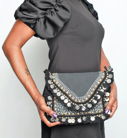 Woman carrying  'Ananda' Tribal Clutch, tribal accessories
