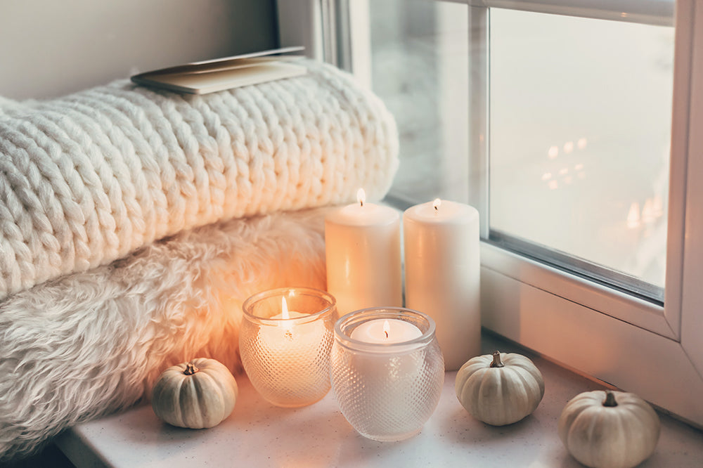 candles and cozy textiles