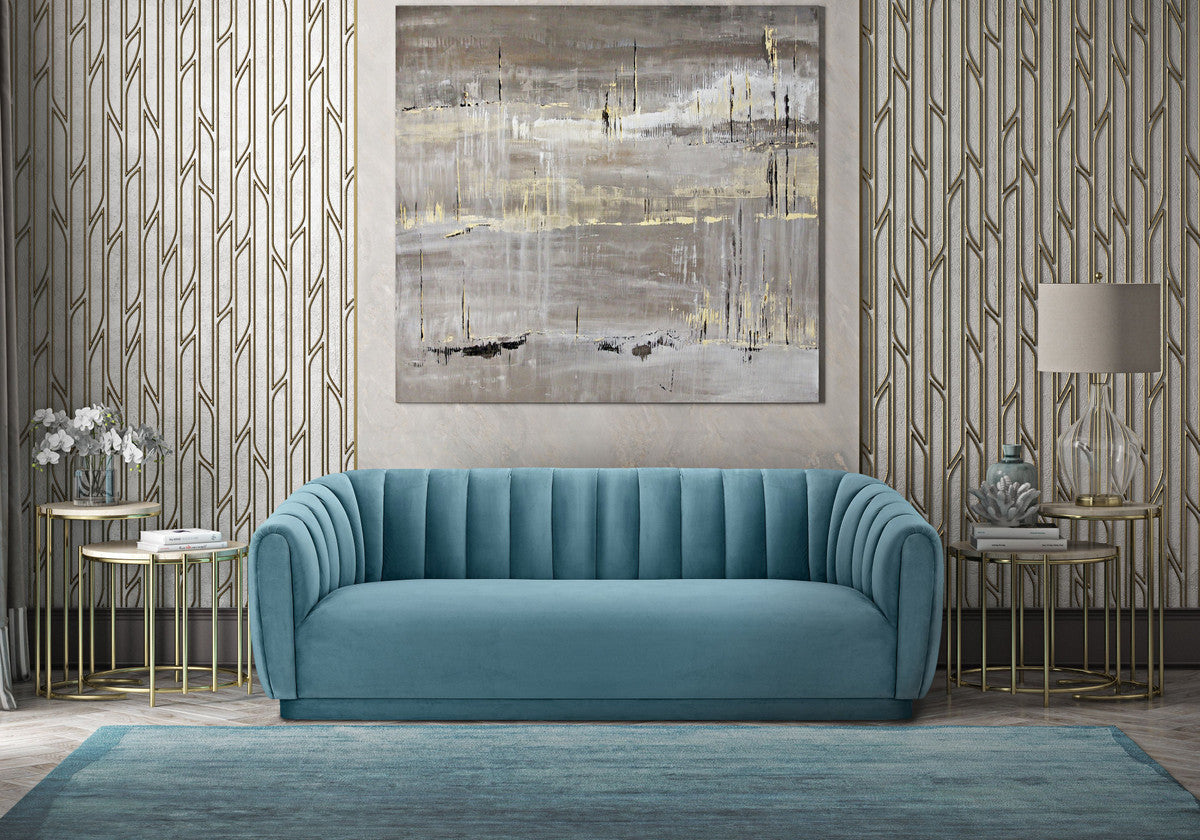 Timeless and inviting in lush sea blue velvet, the lavish channel tufted Daphne Sofa is the piece you've been searching for.