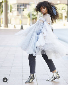 Nomalanga Shozi wearing grey tulle ruffle smocked dress with full sleeves