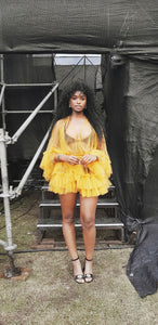 Nomalanga Shozi wearing sheer yellow tulle lingerie dress with ruffles over bikini