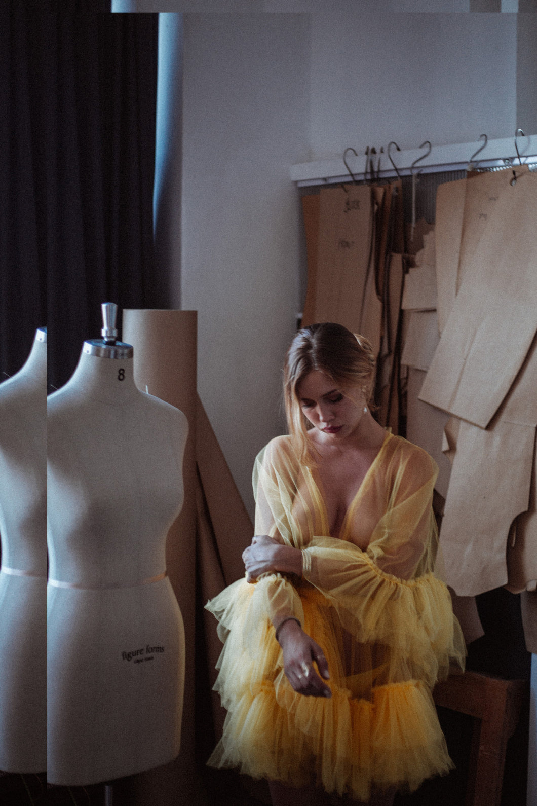 Model wearing sheer yellow tulle dress with ruffles