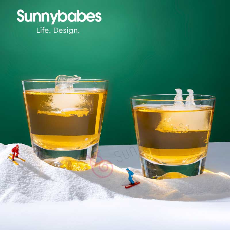 Polar Bear and Penguin Shape Ice Cube Molds.Let the North Pole and the South Pole float in your cup!