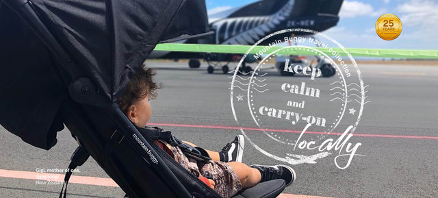 toddler in nano single buggy at airport keeping calm and carrying on