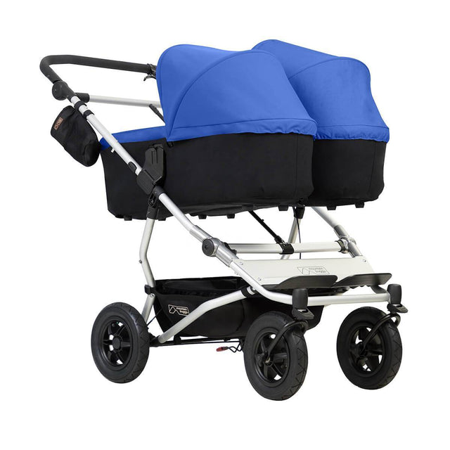 Mountain Buggy duet double buggy with two carrycot plus in lie flat mode 3/4 view shown in color marine _marine