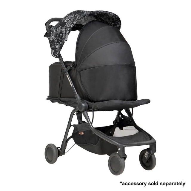 Mountain Buggy newborn cocoon on a carrycot stand in colour black_black