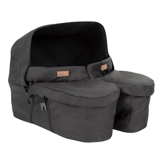 close up of the carrycot plus for twins shown from the front side on with the cover and sun hood in place_black