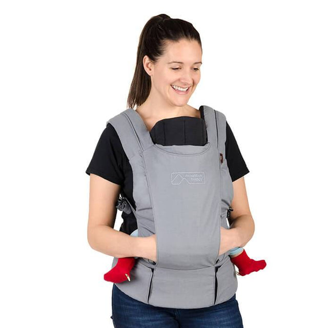 mountain buggy juno baby carrier in charcoal grey colour with infant insert in use_charcoal