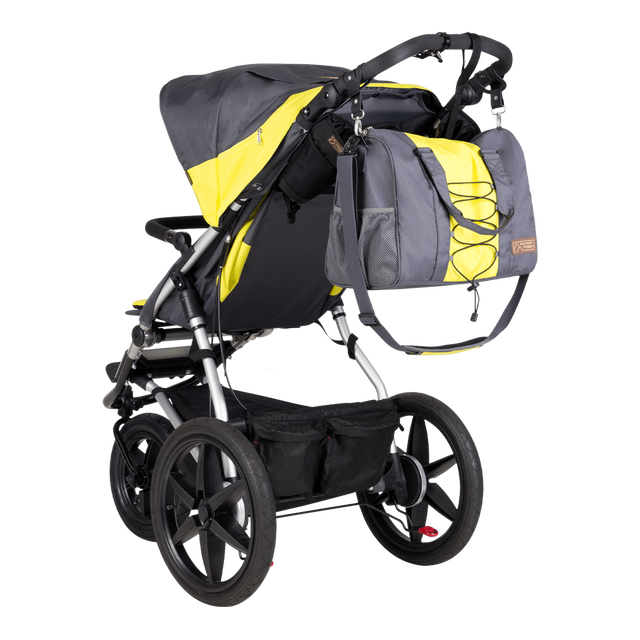 Mountain Buggy parenting bag attached to the terrain buggy in matching colour yellow and slate grey solus_solus