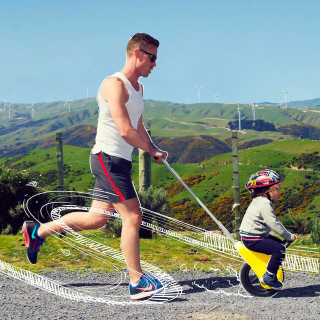 Mountain Buggy unirider with dad pushing his son while jogging_yellow